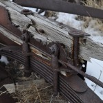 Photography- A close up shot of leaf springs showing rust and wood